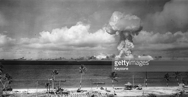 Mushroom cloud forms after the initial Atomic Bomb test explosion off the coast of Bikini Atoll, Marshall Islands.