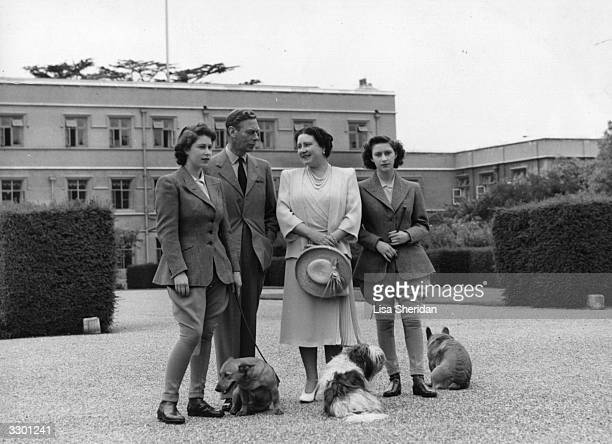 King George VI and Queen Elizabeth with their daughters, Princess Margaret Rose and Princess Elizabeth at the Royal Lodge, Windsor.