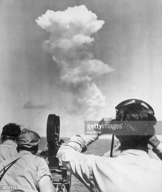The huge swirling mushroom cloud that billowed up from Bikini lagoon seconds after the detonation of the Atomic Bomb and observers and photographers...