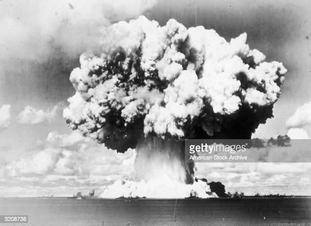 View of a rising mushroom cloud following an American test explosion of an atomic bomb on Bikini Island