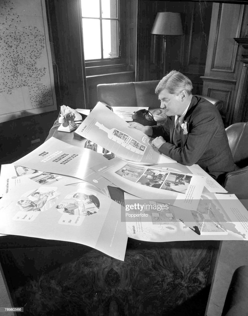 July 1948, Aneurin Bevan, the Labour politician who as minister of health inaugurated the free National Health service, pictured in his London office studying posters prior to the NHS launch