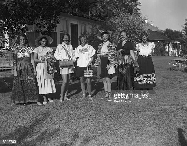 Full-length portrait of socialites Jacqueline Bouvier , Valerie Starke, Patricia Skidmore, Jean Washburn, Teloline Crabbe, Elizabeth Fly, and Anne...