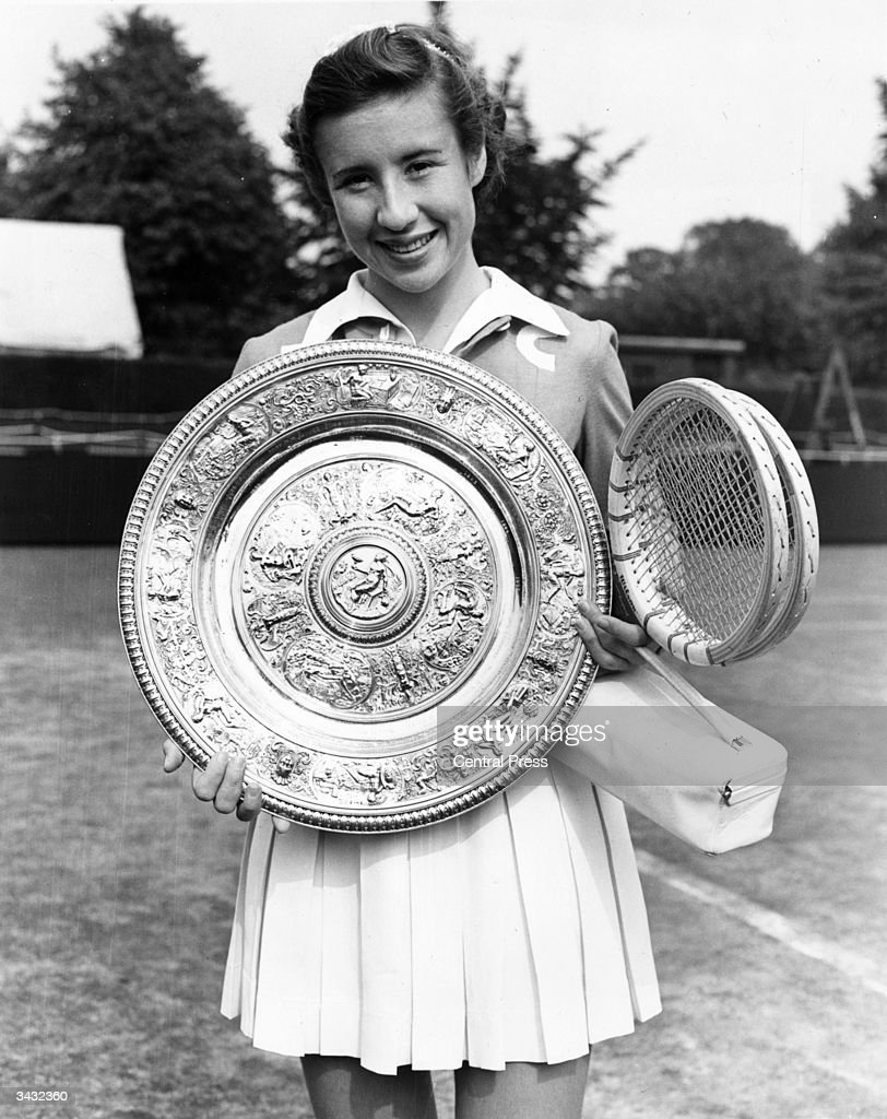 American tennis player Maureen Connolly (Little Mo) with the women's singles trophy after beating Doris Hart in the final at the Wimbledon Lawn Tennis Championships.