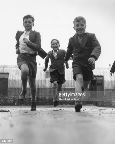 Children giving their shoes some rough and tumble treatment on behalf of Clarks shoe manufacturers, who pay pocket money to the children for...