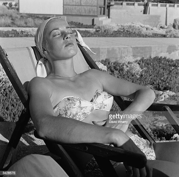 Sunbather relaxes at Hotel du Cap at Eden Rock in Cap Ferrat near Nice.