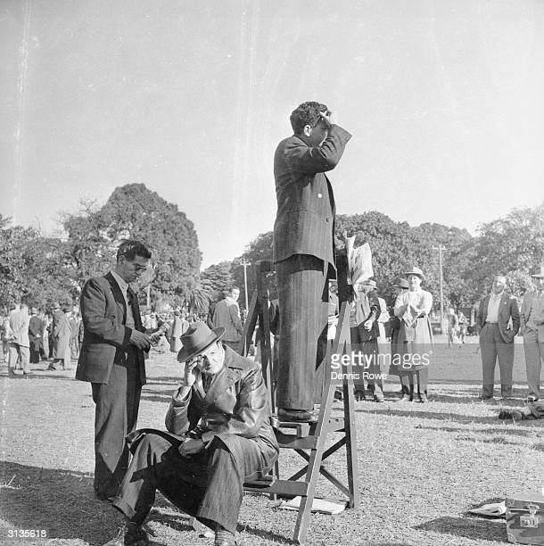 A public speaker addresses a small gathering in the Domain Sydney