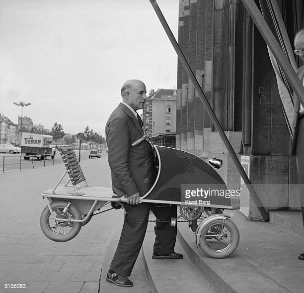 Fernando Ruiz Luciarte manoeuvres his invention the OtoPedal up the stepsof his Paris office The vehicle specially designed for elderly people is...