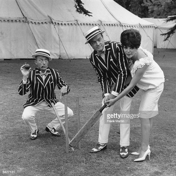 Bing Crosby, Bob Hope and Joan Collins playing a game of cricket on the set of 'The Road To Hong Kong' on the first day of filming at Shepperton...