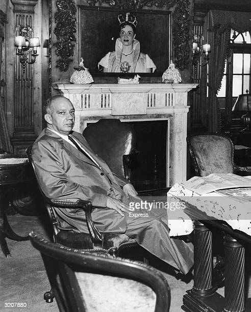 Portrait of Hector Trujillo former president of the Dominican Republic sitting at a table in front of the fireplace in the living room aboard his...