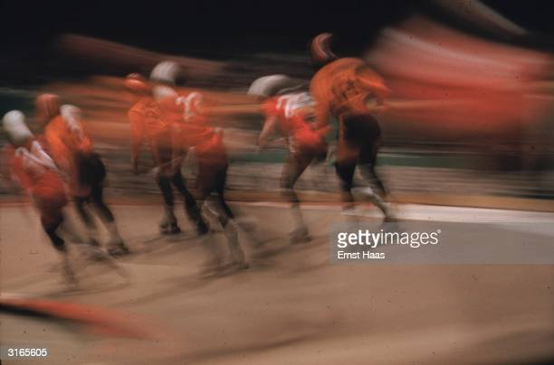 Skaters in red tops take part in an American roller derby
