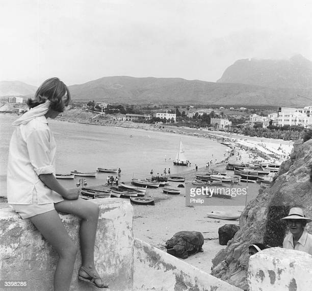 A tourist admiring the view over the beach at Benidorm