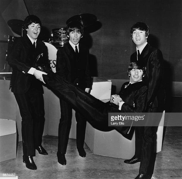 Ringo Starr being given the bumps by the other members of popular rock group The Beatles on his 24th birthday From left to right Paul McCartney...
