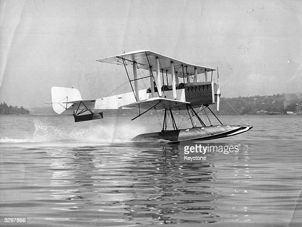 A 1916 seaplane biplane the first model to be produced by the Boeing aircraft company is seen here flying again at Seattle Washington It has a top...