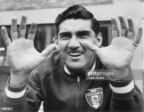 Antonio Carbajal the Mexican goalkeeper showing his injured left hand during a training session in Hertfordshire