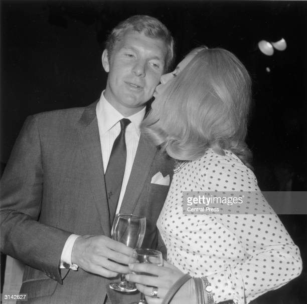 England football captain Bobby Moore receives a kiss from his wife Tina during the celebrations of England's victory in the 1966 World Cup