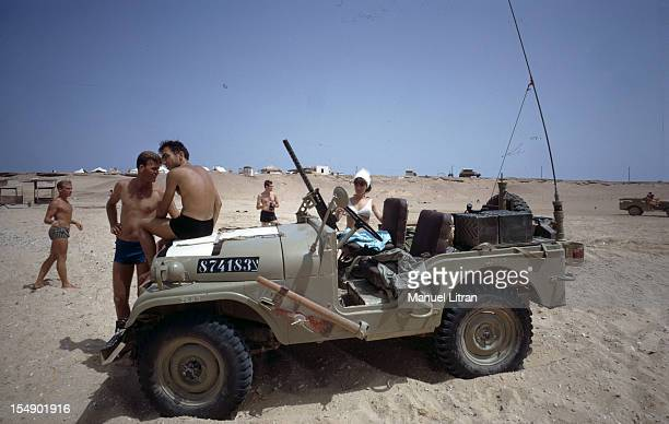 July 1967 after the 'Six Day War' Israel tripled its surface area On a beach Israeli swimsuit sitting on a military vehicle weapon