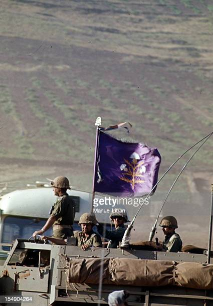 July 1967 after the 'Six Day War' Israel tripled its surface area Israeli soldiers on a truck on which floats a purple flag with white flowers