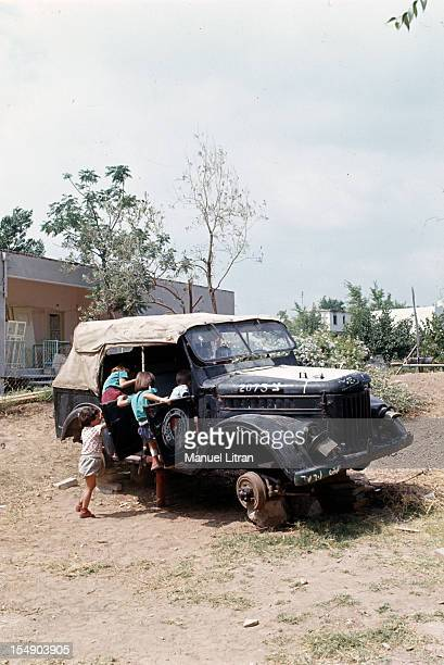 July 1967 after the 'Six Day War' Israel tripled its surface area The new frontier of the Hebrew state Children play in an old car wreck