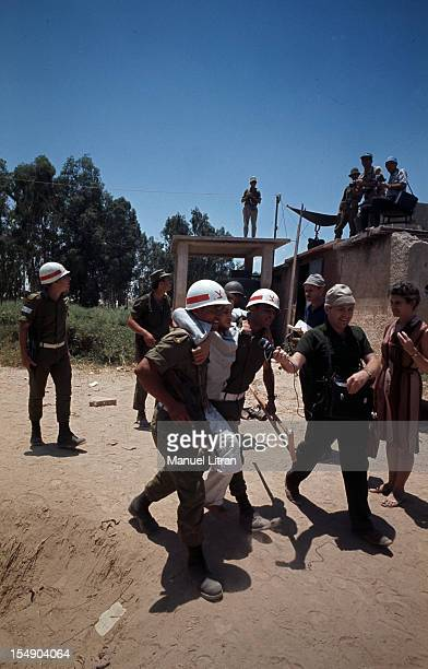 July 1967 after the 'Six Day War' Israel tripled its surface area The new frontier of the Hebrew state Israeli soldiers carry a wounded man