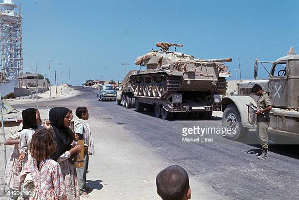 July 1967 after the 'Six Day War' Israel tripled its surface area The new frontier of the Hebrew state Palestinian children watch Israeli tanks...