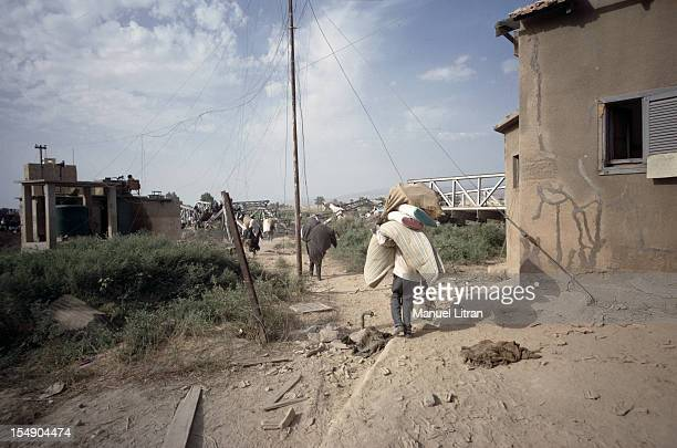 July 1967 after the 'Six Day War' Israel tripled its surface area The new frontier of the Hebrew state Palestinians leave their homes A man carries a...