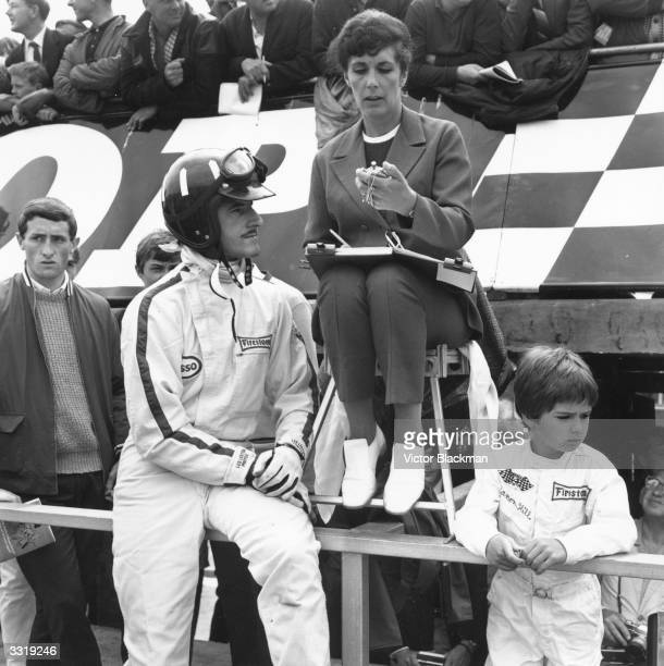 British racing driver Graham Hill with his wife and his six-year-old son Damon, who went on to become a world champion driver himself, at Silverstone.