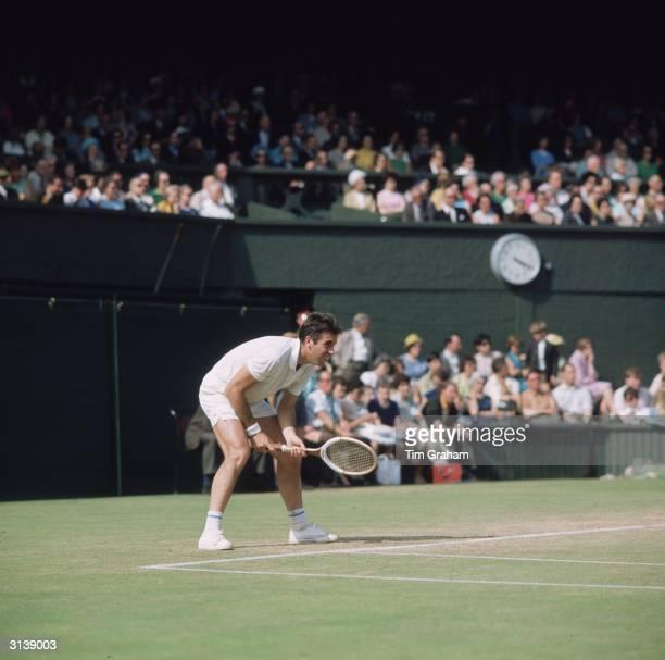 Spanish tennis player Manuel Santana in action at Wimbledon