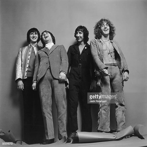 LR Bassist John Entwistle drummer Keith Moon guitarist Pete Townshend and singer Roger Daltrey of the British rock group The Who pose smiling for a...