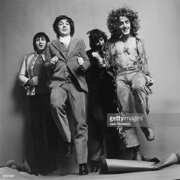 LR Bassist John Entwistle drummer Keith Moon guitarist Pete Townshend and singer Roger Daltrey of the British rock group The Who run in place for a...