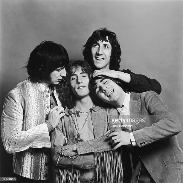 LR Bassist John Entwistle singer Roger Daltrey guitarist Pete Townshend and drummer Keith Moon of the British rock band The Who pose in a cluster for...