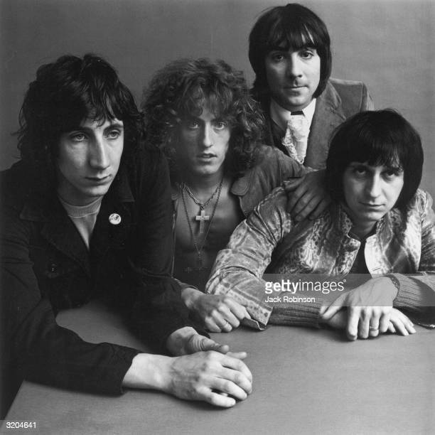 Guitarist Pete Townshend, singer Roger Daltrey, drummer Keith Moon , and bassist John Entwistle pose around a table for a feature in Vogue magazine....