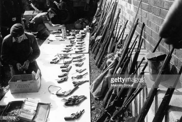 British soldiers sorting through a weapons cache in Belfast