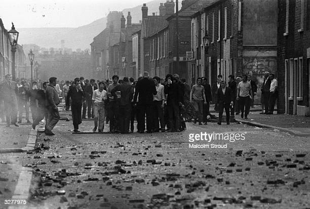 Five Catholics are killed 60 injured and hundreds of homes devastated when armed British soldiers impose a curfew in the Falls Road area of Belfast