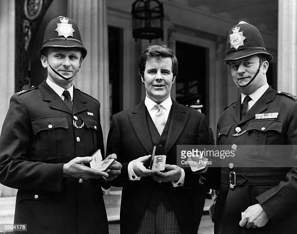 Police constables George Burrows James Smith and Stanley Conley of the Metropolitan Police proudly display their British Empire medals for gallantry...