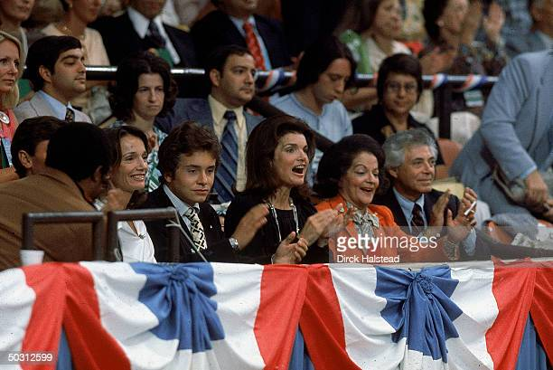 Former First Lady Jackie Kennedy Onassis w sister Lee Radziwill and Radziwill's son Anthony applauding at Democratic National Convention