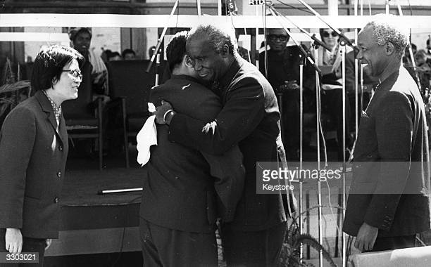 President Nyerere watches as President Kenneth Kaunda of Zambia greets the Chinese VicePremier Sun Chien at the handing over ceremony of the Tanzania...