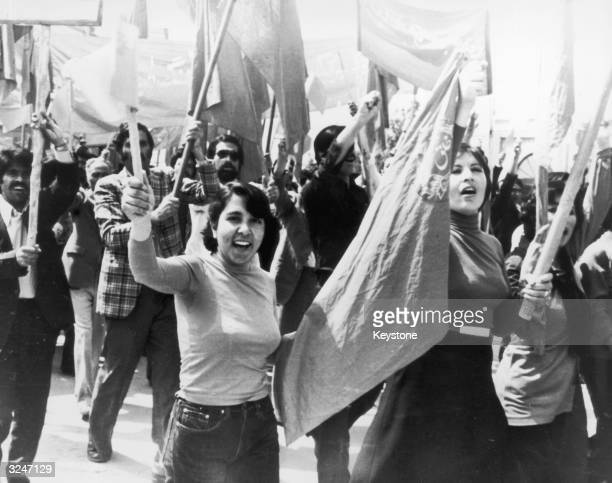 Female workers join the men on a march in Kabul.