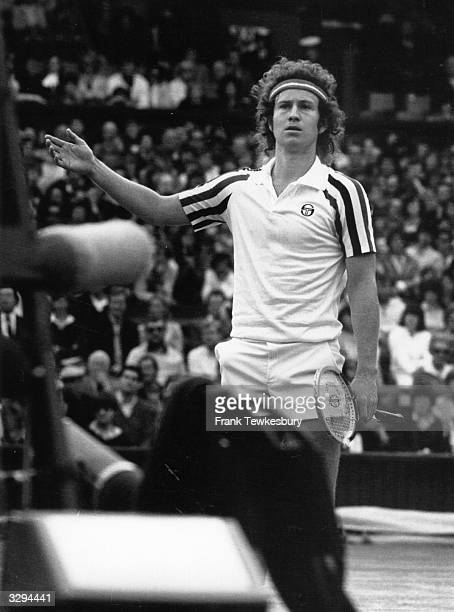 American tennis player John McEnroe disputes the umpire's call during a match at the Wimbledon Lawn Tennis Championships