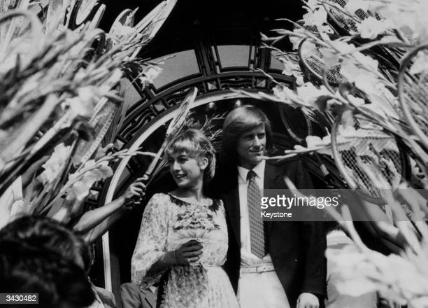 Tennis ace and Wimbledon champion Bjorn Borg and his bride Mariana Simionescu married in Romania. They walk through an arch of tennis racquets and...