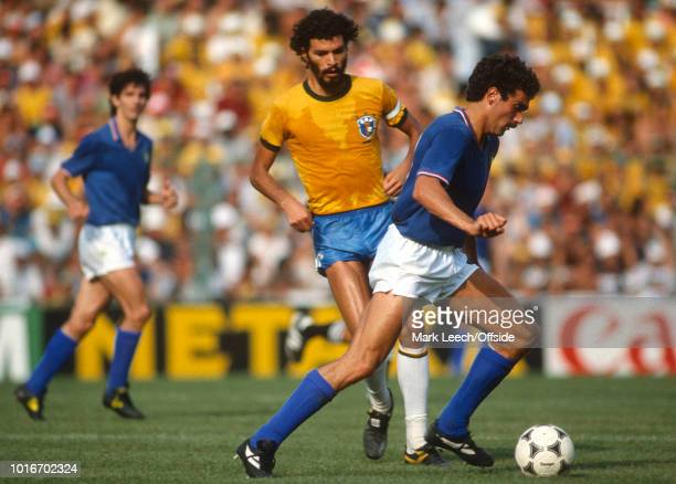 05 July 1982 FIFA World Cup Italy v Brazil Giuseppe Bergomi of Italy on the ball watched by Socrates of Brazil