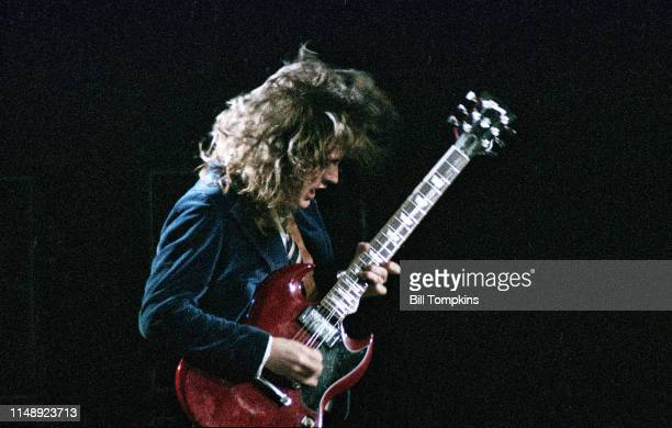 July 1983]: MANDATORY CREDIT Bill Tompkins/Getty Images on Angus Young lead guitarist of AC/DC performs at Madison Square Garden July 1983 in New...