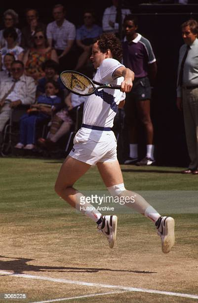 John McEnroe American tennis star and bad boy of the tennis circuit in action at the Wimbledon Tennis Championships