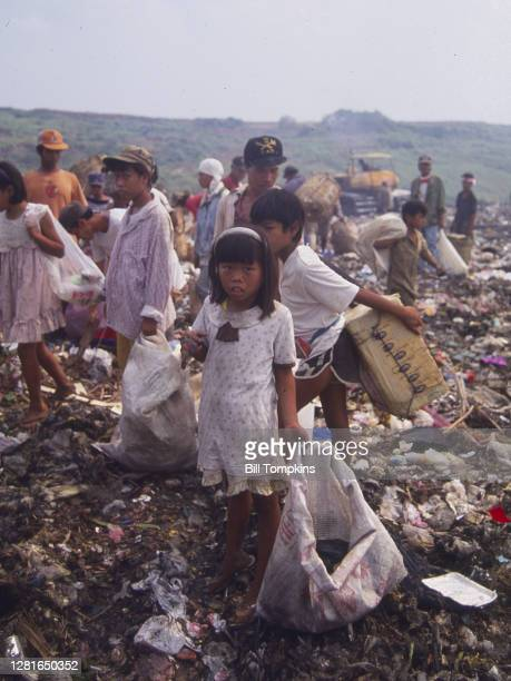 July 1988]: MANDATORY CREDIT Bill Tompkins/Getty Images The Payatas Dumpsite, a 13 hectare garbage dumpsite. The site houses a 50-acre landfill which...