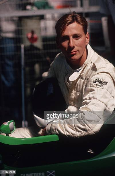 The Earl of Dumfries Johnnie CrichtonStuart son of the Marquess of Bute at Silverstone with the Benetton 188 Formula 1 car