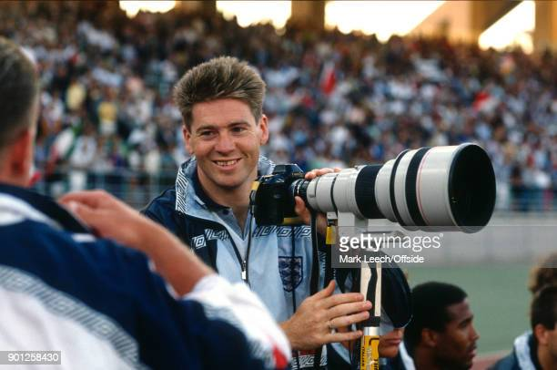 Fifa World Cup 3rd place match Italy v England Chris Waddle holds the camera and telephoto lens of a photographer