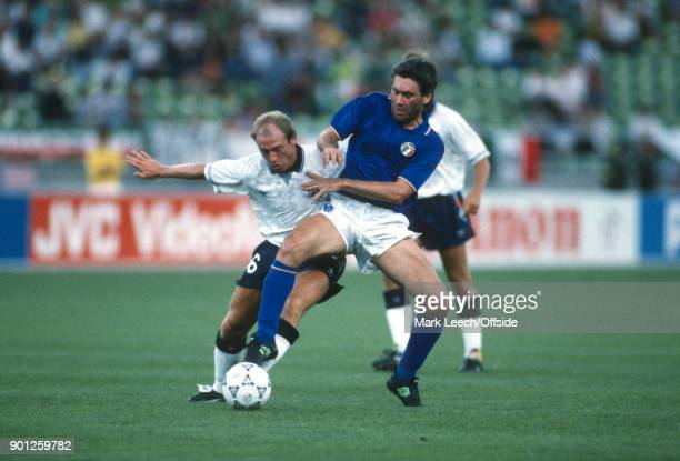 July 1990 Bari - FIFA World Cup : 3rd place play off match - Italy v England - Steve McMahon of England tackles Carlo Ancelotti .