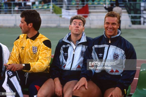 07 July 1990 Bari FIFA World Cup third place match Italy v England Chris Waddle makes a facial expression on the England bench to the amusement of...