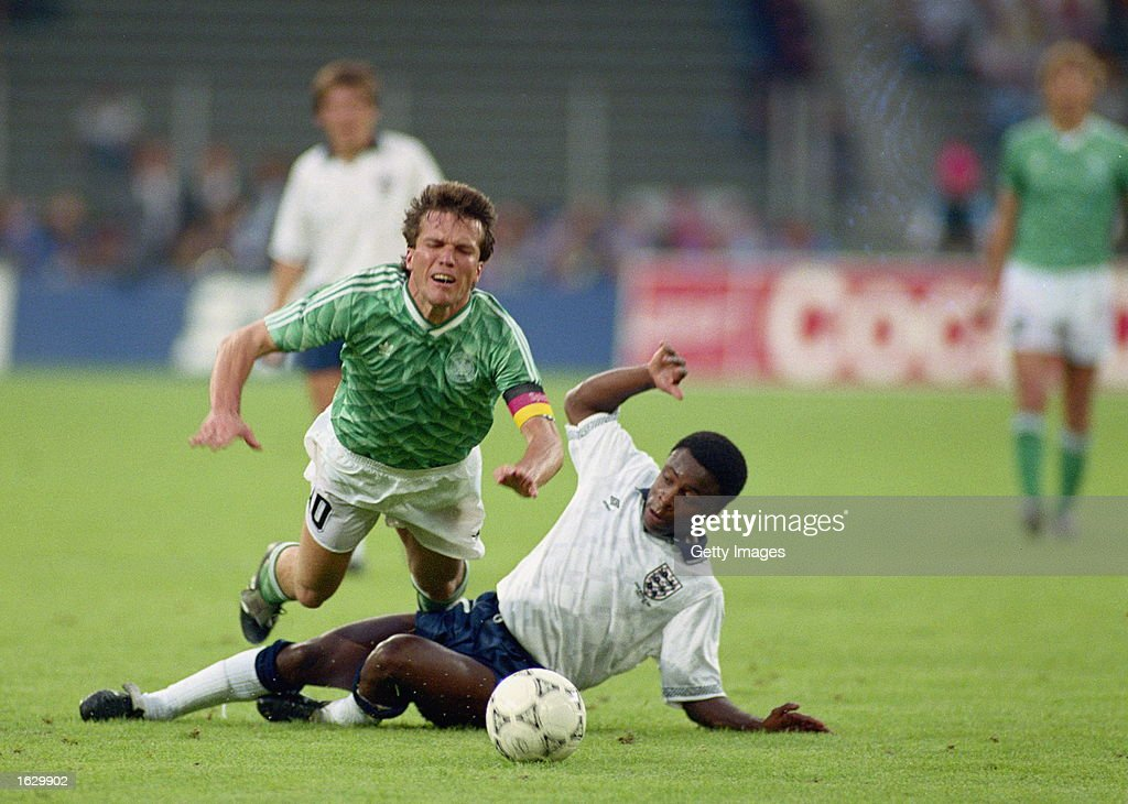 Lothar Matthaus of Germany and Paul Parker of England : News Photo