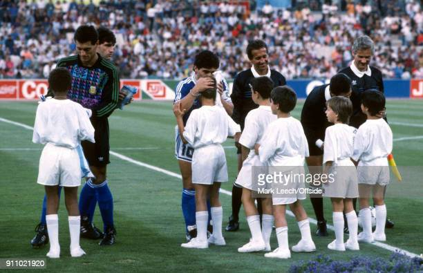 FIFA World Cup Final Argentina v West Germany Diego Maradona of Argentina embraces one of the mascots