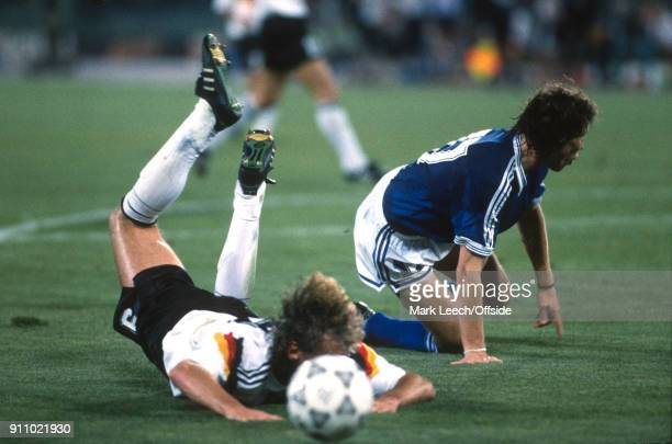 World Cup Final ; Argentina v West Germany - Rudi Voeller of Germany is fouled by Roberto Sensini of Argentina leading to the decisive penalty kick .